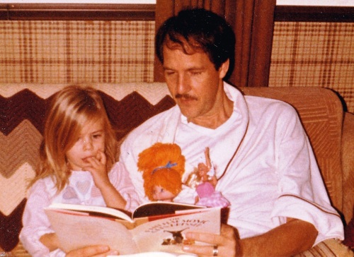 My dad reading to baby Julz, Rainbow Bright, and Barbie